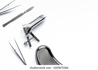 instruments of gynecologist on white background top view