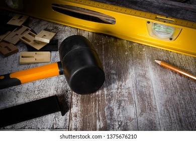 Instruments for installing laminate floor on laminate