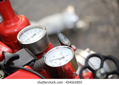 Instruments of a red firefighter centrifugal pump