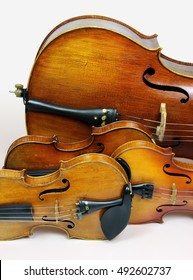 Instruments of a string quartet in a row: two violins, viola and violoncello