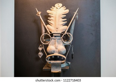 Instruments of torture times of inquisition, mask on a gray background with space for text