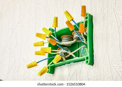 Insulated electrical twist nut connector for twisting electrical wires inside junction box in home wiring.