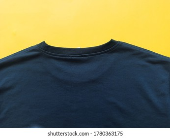 Insulated T-shirt jacket with a yellow background.