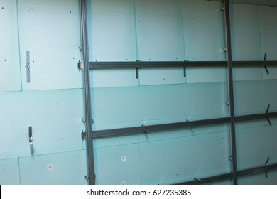 The insulated wall inside the building and unfinished repair