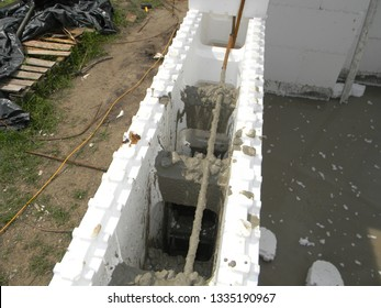 Insulating concrete forms ICF  with reinforced concrete house walls. Insulating concrete forms ICF made of plastic foam that construction crews stack into the shape of the walls of a building.