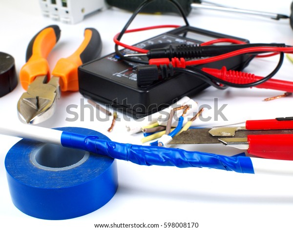 insulating electrical wire connection with blue electric tape, shallow depth of field