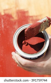 insulating paint a wood with red paint