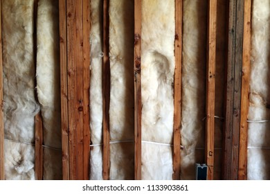 Insulation in between wooden beams. Natural light.