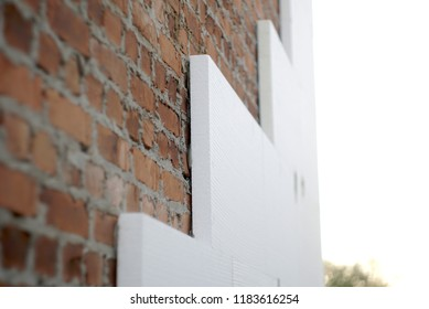 insulation of a brick wall with polystyrene white