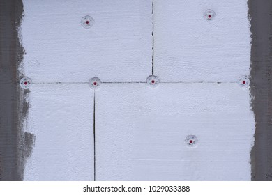 Insulation from expanded polystyrene on a wall of several sheets close-up with a place for an inscription