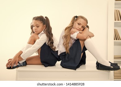 insult. insult of two small girls children or sisters at school. small girls in school uniform