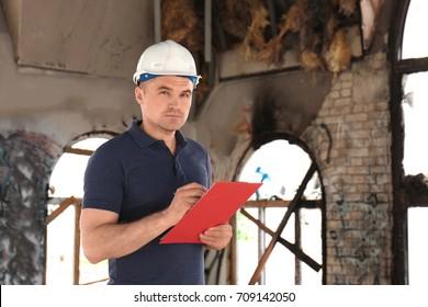 Insurance adjuster inspecting abandoned building