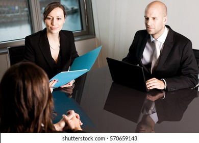 Insurance advisor with a costumer in a nice office