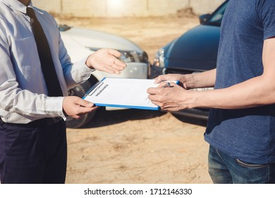 Insurance agent giving the car owner is sign the agreement for accident claim, Car insurance concept.