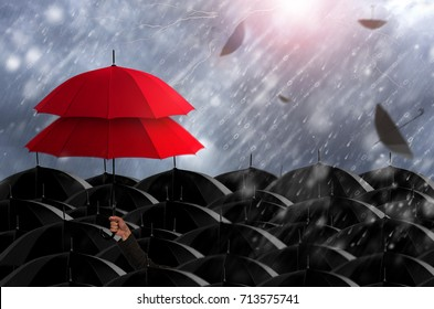 Insurance agent holding red umbrella two layers to protect the life, health, savings, investment and accident, Insurance concept.