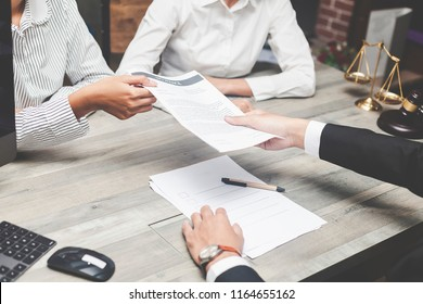 insurance agent or legal advice consulting concept. Notary or lawyer or judge consult having team meeting with client in office. salesman making offer to young couple or customers about mortgage