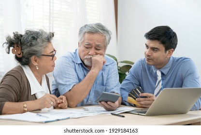 An insurance agent offers health insurance for Asian elderly couples, Finance staff present and close real estate sales.