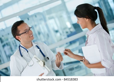 Insurance agent talking to a doctor making business