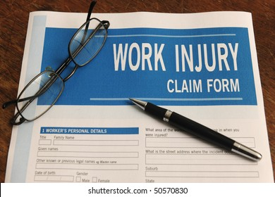 insurance: blank work injury claim form on desk