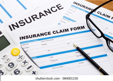 Insurance claim concept with pen and calculator