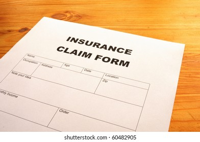 insurance claim for on desk in office showing risk concept