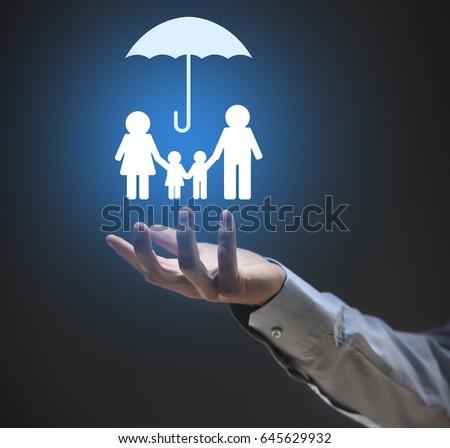 Insurance Concept Businessman Holding Symbol Family Stock Photo