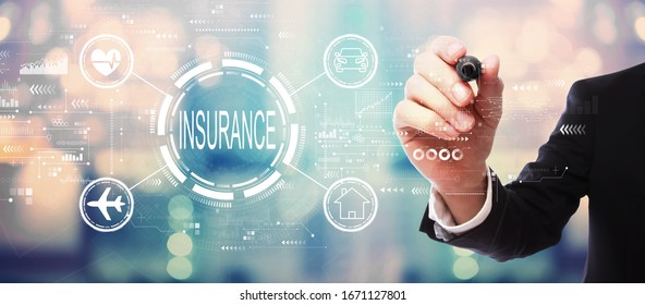 Insurance concept with businessman on blurred abstract background