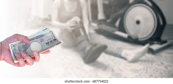 Insurance concept, closeup hand woman with Japanese currency yen bank notes on blurred background