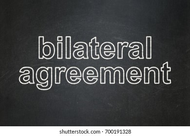 Insurance concept: text Bilateral Agreement on Black chalkboard background
