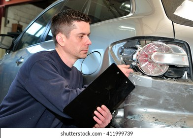 Insurance  employee working with a car.