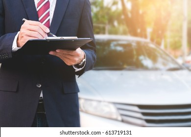 An insurance expert employee working with a car at outdoor