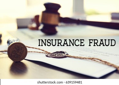 Insurance fraud concept. Document, notarial seal and stamp on table