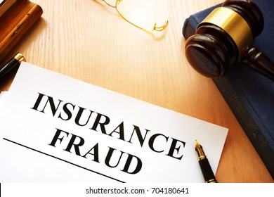 Insurance fraud written on a documents and gavel.