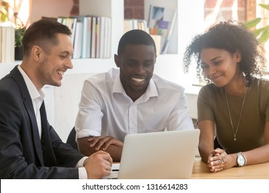 Insurance mortgage broker salesman consulting african couple showing online presentation on laptop in office, realtor insurer financial advisor making offer to young black clients looking at computer