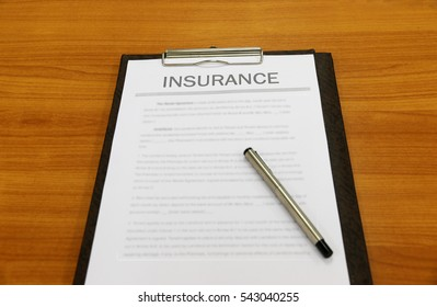 Insurance on table in Office Business