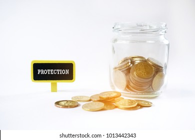 Insurance plan concept. PROTECTION word on mini chalkboard with coins and glass jar isolated on white background