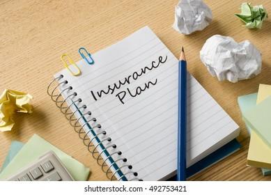insurance plan on notebook on desk