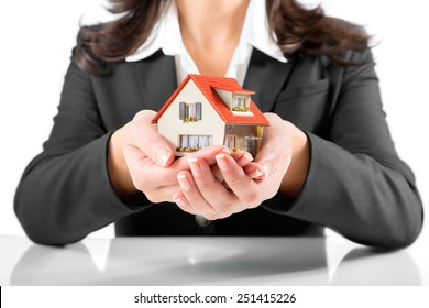 insurance and protection concept - realtor woman give a house