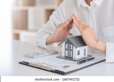 insurance protective hand over house for protection and care, Concept of home and real estate Property insurance