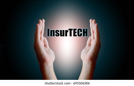 Insurance technology (Insurtech) concept, Human hand holding and protect text with virtual screen on back blackground.