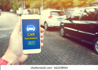 Insurance technology (Insurtech) concept and man hand holding smartphone for car insurance.