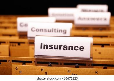 insurance word on business folder showing risk management concept