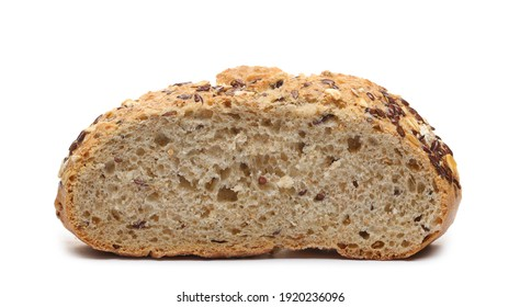 Integral wheat rye bread loaf with seeds (linseed and oats) sliced in half isolated on white background