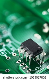 Integrated circuit electronic component on the green printed circuit board or PCB