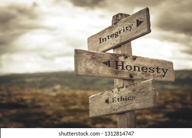 Integrity, honesty and ethics signpost in nature. Message, quotes, words, meaning, goals, company, business, rules, path concept.