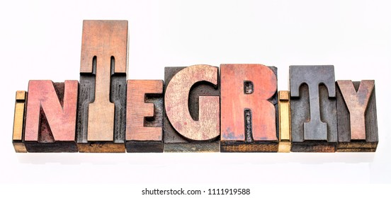 integrity  - isolated word abstract in vintage letterpress wood type blocks