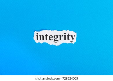 Integrity text on paper. Word Integrity on torn paper. Concept Image.