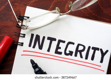 Integrity written in a notebook. Business concept.