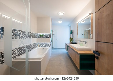 Inteior of modern bathroom with bathtub