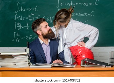 Intellectual intimacy. Sexy woman and bearded man feeling intimacy in class. Intimacy between teacher and student. Intimacy in school. Intimate relationship at work or study.